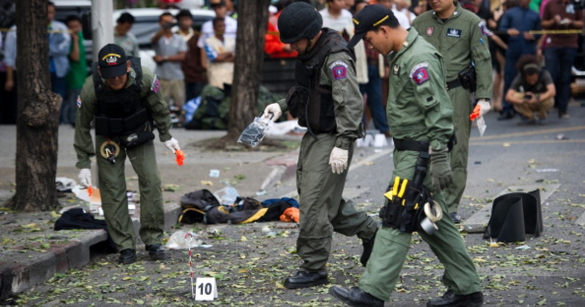Thai bomb squad officials inspect the site of an explosion in Bangkok on February 14, 2012. Three minor blasts rattled the Thai capital Bangkok, leaving a foreigner seriously wounded when a grenade he was suspected of carrying exploded, police said. AFP PHOTO/ Nicolas ASFOURI (Photo credit should read NICOLAS ASFOURI/AFP/Getty Images)</p>