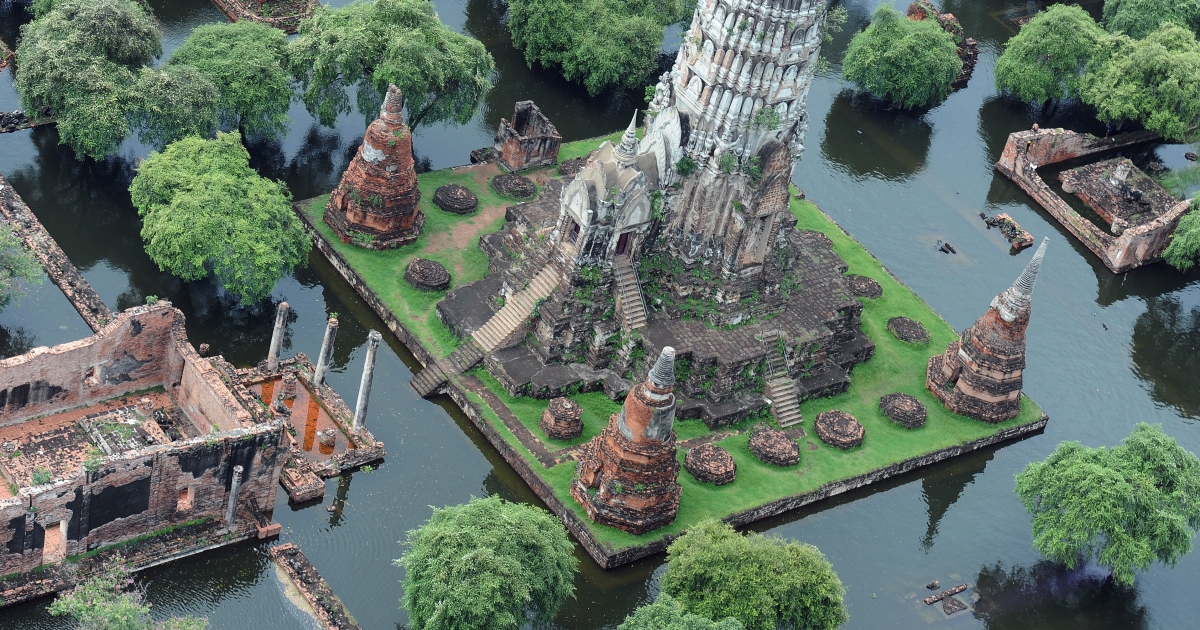 This aerial picture shows a temple surrounded by flood waters in the ancient capital city of Ayutthaya, north of Bangkok, on October 16, 2011. Flood defenses protecting the Thai capital held up on October 16, but the advancing waters that have swamped the inland still threaten to engulf Bangkok in a disaster that has claimed 300 lives. Thailand's worst floods in decades have inundated huge swathes of the kingdom, swallowing homes and businesses, shutting down industry, and forcing tens of thousands of people to seek refuge in shelters.</p>