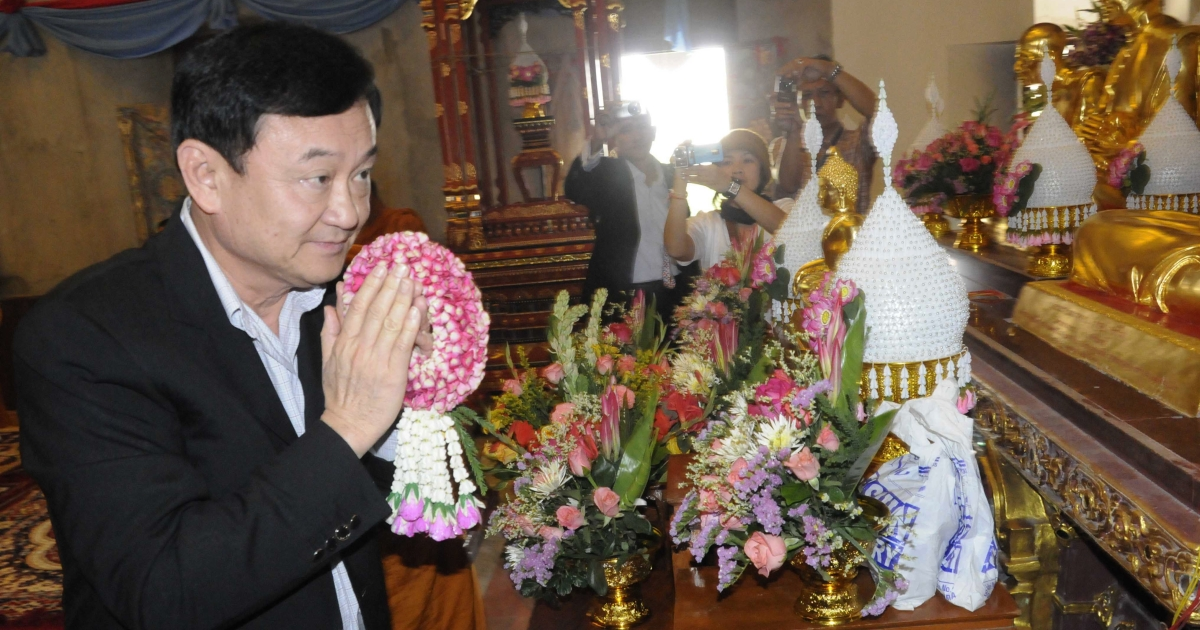 Former Thai prime minister Thaksin Shinawatra during a visit to the Wat Pa Monastery in Bodh Gaya in India's Bihar state on Nov. 4, 2011. Thaksin made a religious visit to the Buddhist pilgrimage site.</p>