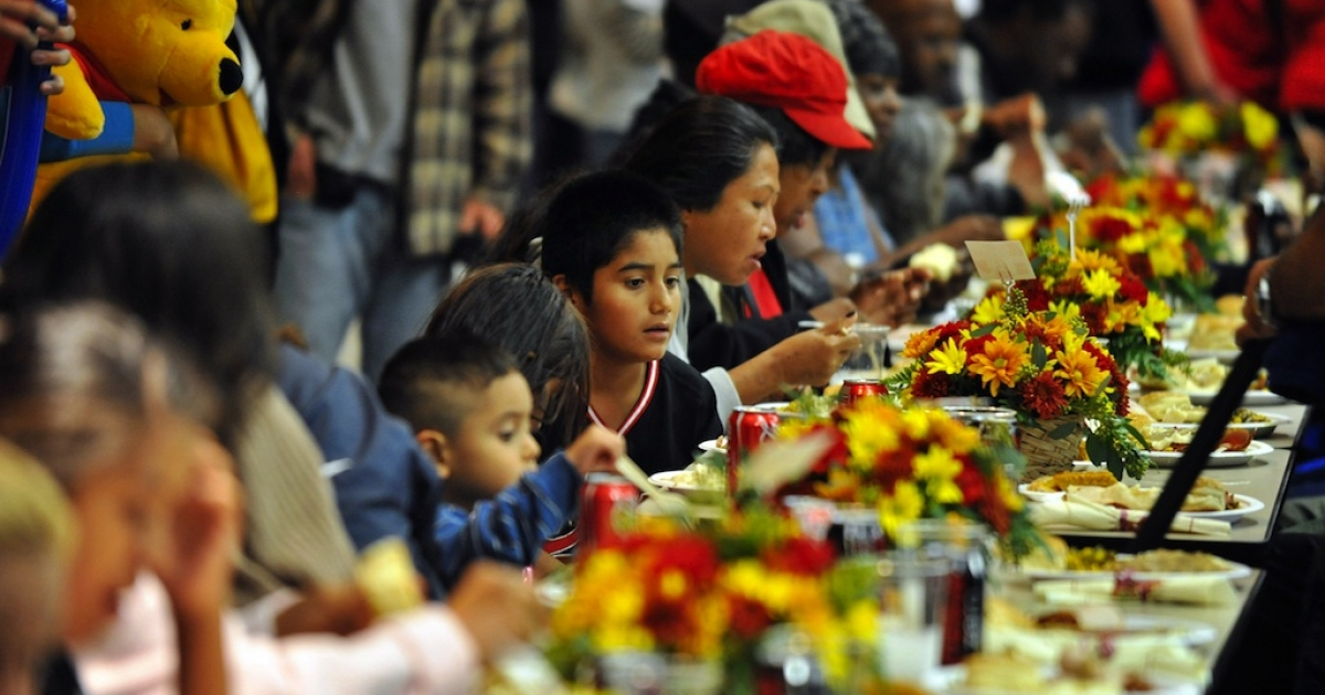Families enjoy free Thanksgiving meals in downtown Los Angeles, Calif., on Nov. 26, 2008.</p>