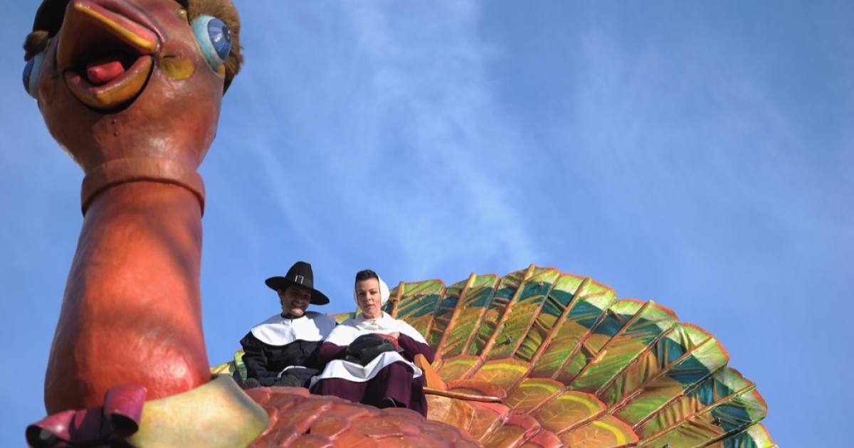 Actress Debi Mazar (R) and husband Gabriele Corcos sit atop a turkey float during the 85th Annual Macy's Thanksgiving Day Parade on November 24, 2011 in New York City.</p>
