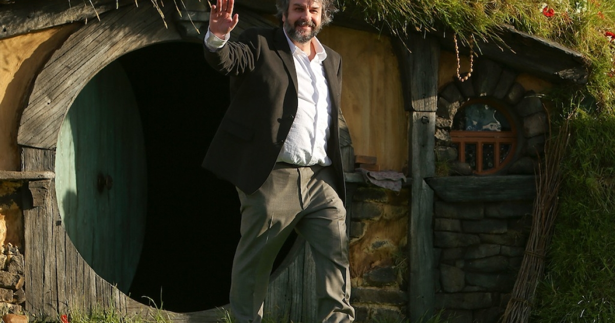 WELLINGTON, NEW ZEALAND - NOVEMBER 28:  Director Sir Peter Jackson emerges from from a Hobbit house before delivering a speech at the 'The Hobbit: An Unexpected Journey' World Premiere at Embassy Theatre on November 28, 2012 in Wellington, New Zealand.</p>