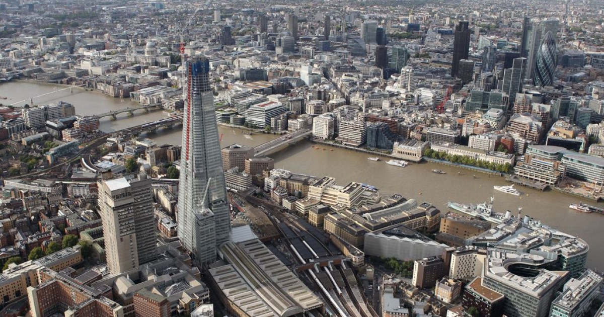 An aerial view of London shows the unfinished Shard skyscraper towering above the rest of the skyline.</p>