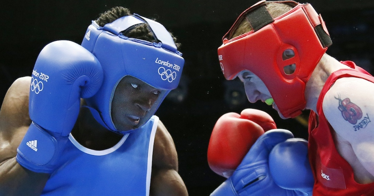Paddy Barnes (R) of Ireland defends against Thomas Essomba (L) of Cameroon during their round of 16 Light-Flyweight match of the London 2012 Olympic Games on August 4, 2012 in London. Essomba is one of seven Cameroonian athletes who has gone missing from the Olympic village.</p>