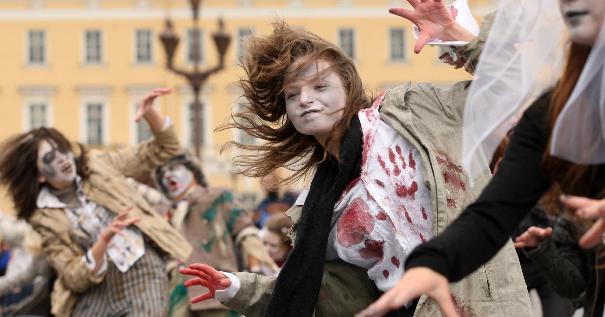 Fans of the late Michael Jackson perform his song 'Thriller' on the Palace square in central St. Petersburg, Russia, on October 23, 2010. Officials are stopping a similar performance in a residential neighborhood in Boca Raton, Fla.</p>