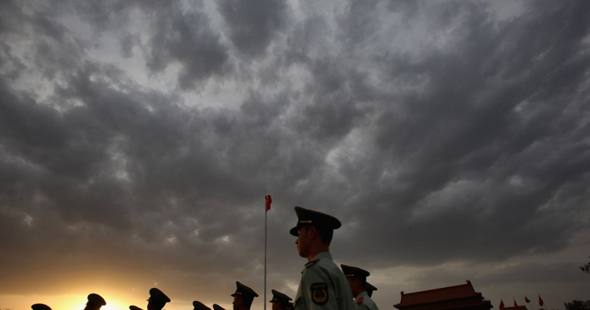 Policemen patrol at the Tiananmen Square in Beijing, China. Chen Xi, a veteran activist who participated in the 1989 Tiananmen protests, was jailed for 10 years today.</p>