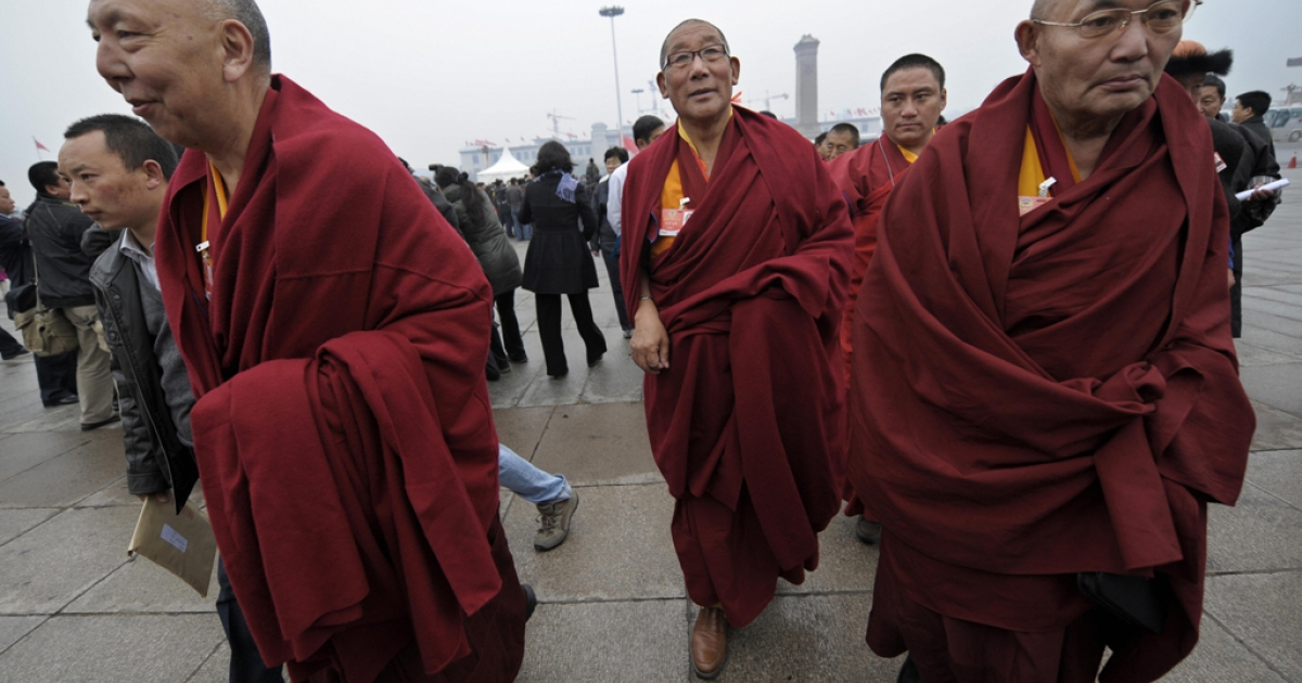 Tibetan monk delegates arrive at the Great Hall of the People in Beijing on March 12, 2009.</p>