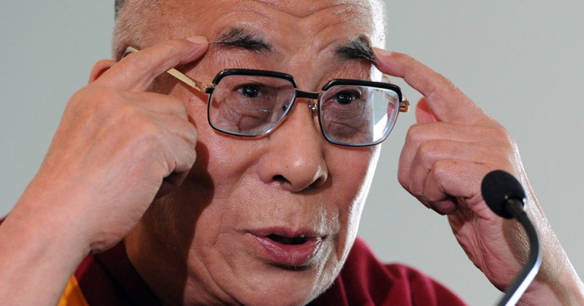 Tibet's spiritual leader, the Dalai Lama, gestures while speaking at Parliament House in Canberra on June 14, 2011.</p>
