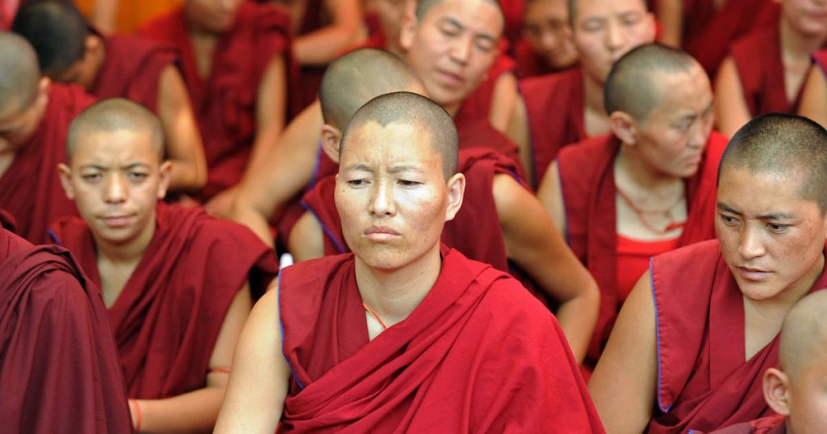 Tibetan Buddhist monks and nuns participate in a sit-in solidarity rally against China's rule on Tibet, in New Delhi on Oct. 18, 2011.</p>