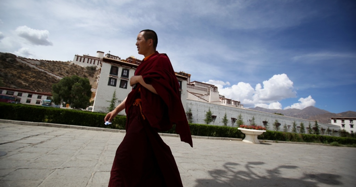 A Tibetan Buddhist monk walks on the Potala Palace square on June 19, 2009 in Lhasa, Tibet Autonomous Region, China. Traditionally, Lhasa is the seat of the Dalai Lama, the capital of Tibet and is the highest capital in the world. The Potala Palace was the chief residence of the Dalai Lama until the 14th Dalai Lama fled to Dharamsala, India, in 1959.</p>