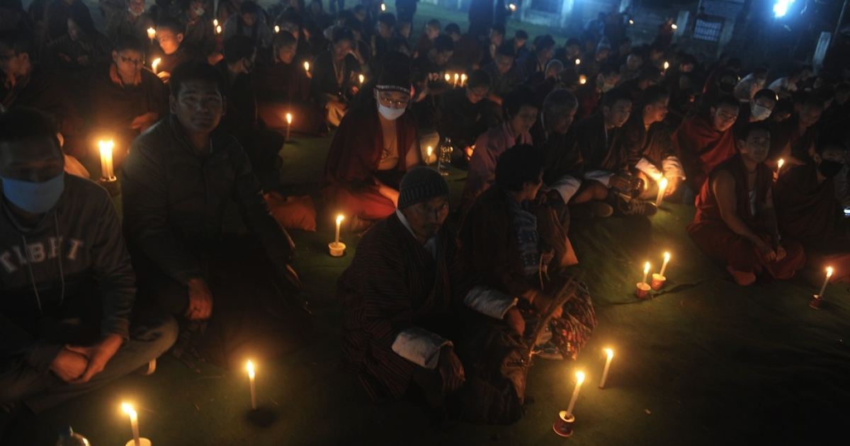 Buddhists attend a candle vigil by the Tibetan Community in memory of self immolations in Tibet during the eighth day of the Kalachakra Festival in Bodhgaya on January 8, 2012. Kalachakra 2012, a festival of teachings and meditations will take place from January 1, 2012 for ten days in the northern Indian state of Bihar and will be attended by Tibetan Spiritual Leader The Dalai Lama.</p>