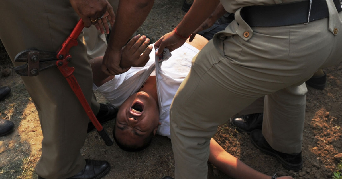 A protester, identified as Sherab Tsedor, screams as he is dragged away by Indian police moments after he tried to set himself on fire in front of the Chinese embassy in New Delhi on November 4, 2011.</p>