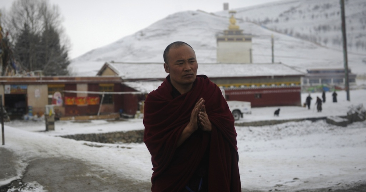 This photo taken on March 11, 2012 shows a Tibetan monk outside the restive Kirti monastery in China's southwestern province of Sichuan.</p>