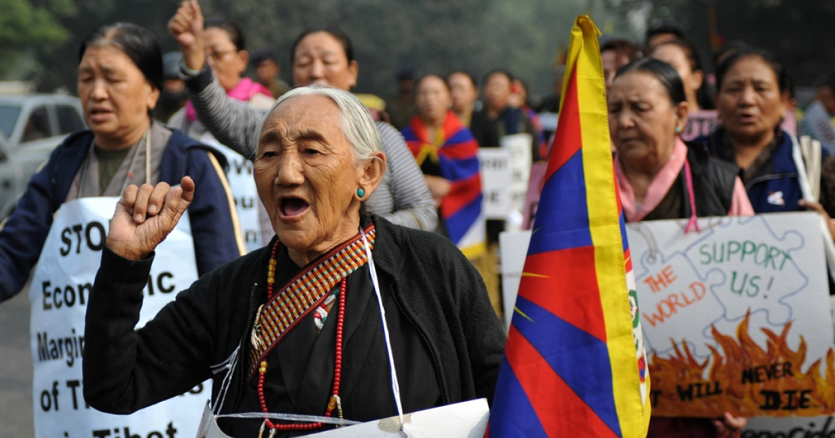Tibetan protesters shout anti-Chinese slogans during a rally by the Tibetan people's solidarity movement near the Chinese embassy in New Delhi on November 23, 2011.</p>