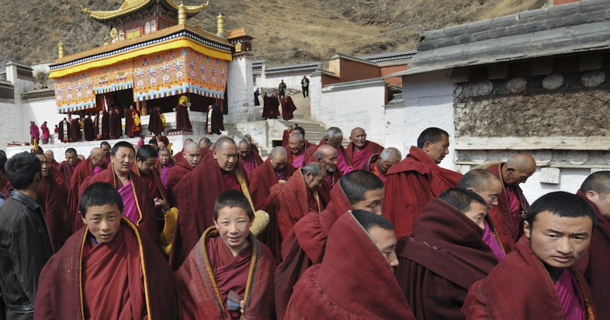 Tibetan Buddhist monks leave a ceremony at the historic Labrang Monastery, which is second only to the Potala Palace in Lhasa in size, in the town of Xiahe, Gansu Province on March 14, 2008.</p>