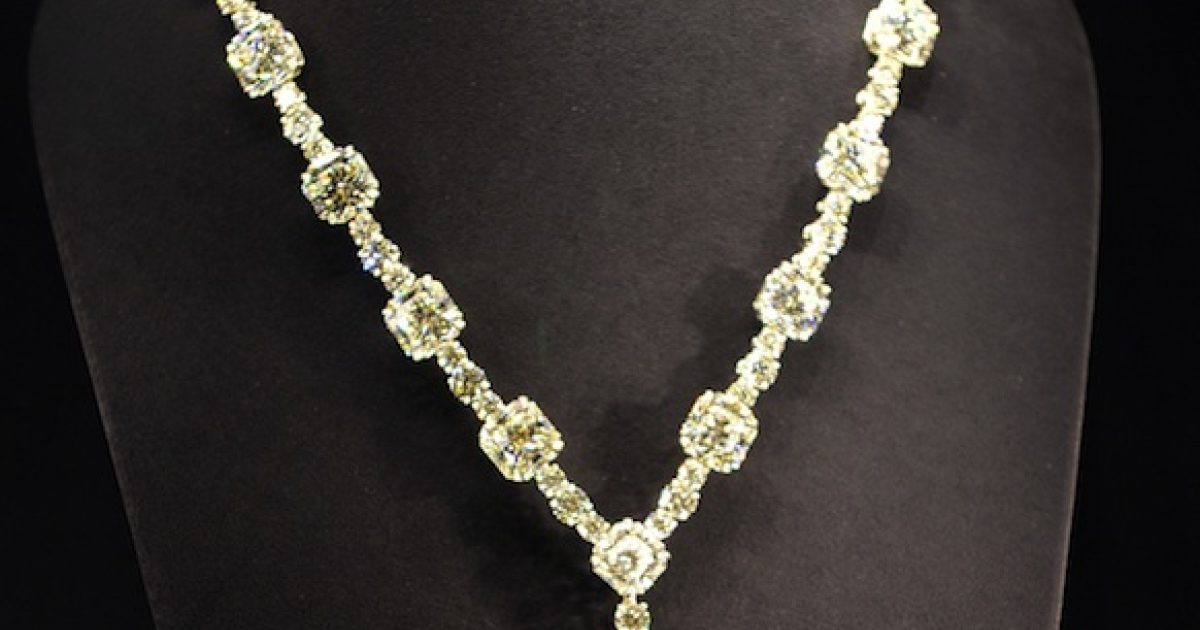 Tiffany &amp; Co displays a diamond necklace with a 128.54 carat yellow diamond at a reception to celebrate the company's 175th anniversary in Tokyo on May 16, 2012.</p>