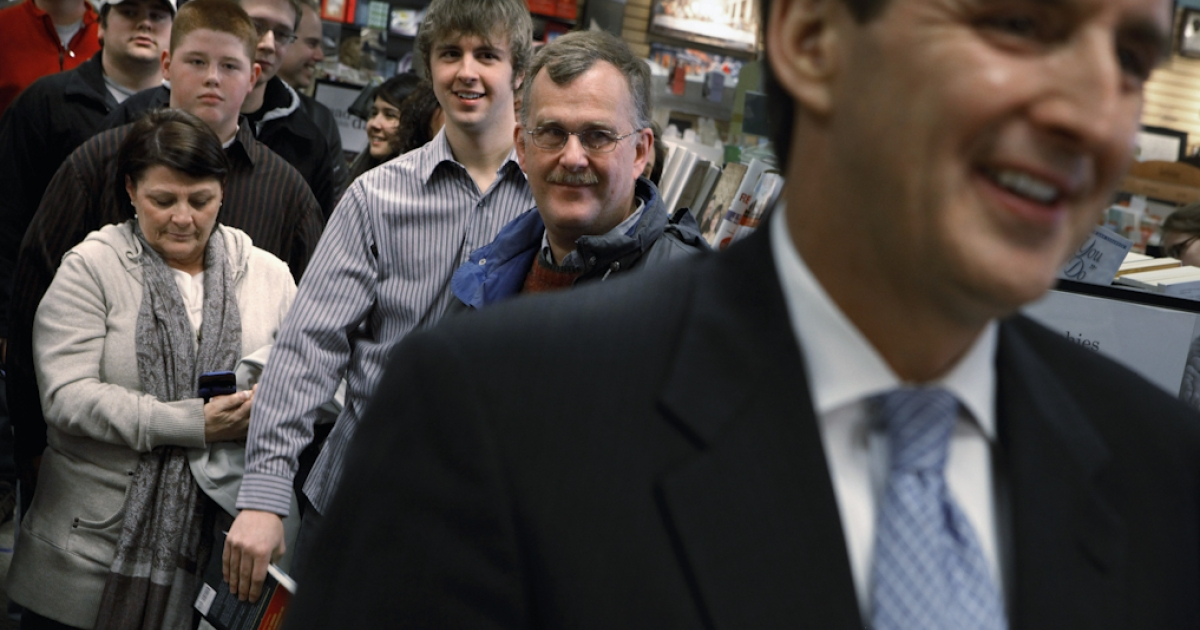 Iowans watch former Minnesota Governor Tim Pawlenty (R) talk to news reporters before having Pawlenty sign their copies of his book, 'Courage to Stand,' in Ankeny, Iowa. On August 14, 2011, Pawlenty announced he will end his campaign for the Republican presidential nomination.</p>