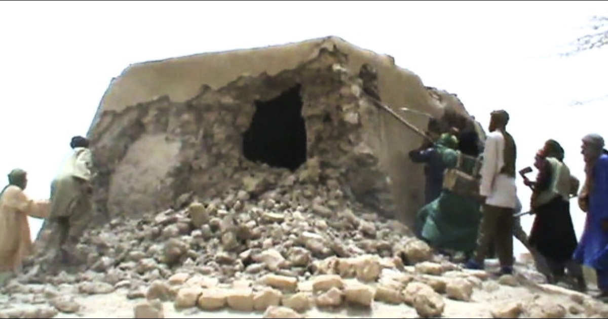 EXCLUSIVE IMAGES<br />A still from a video shows Islamist militants destroying an ancient shrine in Timbuktu on July 1, 2012. Islamist rebels in northern Mali smashed four more tombs of ancient Muslim saints in Timbuktu on July 1 as the International Criminal Court warned their campaign of destruction was a war crime.  The hardline Islamists who seized control of Timbuktu along with the rest of northern Mali three months ago, consider the shrines to be idolatrous and have wrecked seven tombs in two days. They began their destruction of tombs on JUne 30, 2012, after UNESCO put Timbuktu on its list of endangered world heritage sites.</p>
