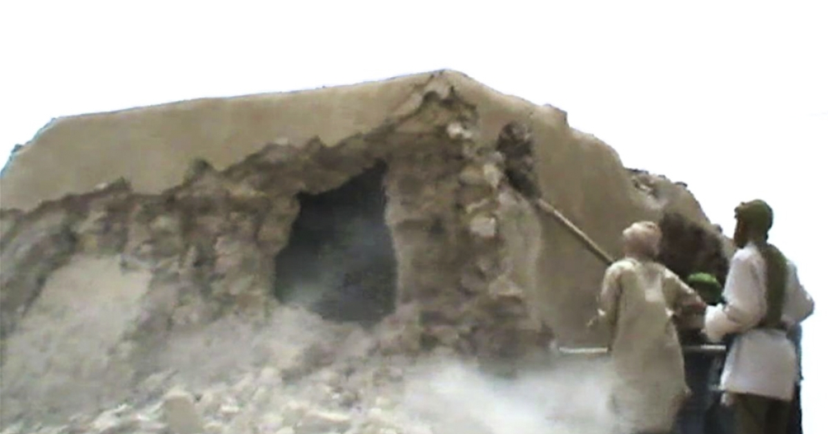 A still from a video shows Islamist militants destroying an ancient shrine in Timbuktu on July 1, 2012. Islamist rebels in northern Mali smashed four more tombs of ancient Muslim saints in Timbuktu on July 1 as the International Criminal Court warned their campaign of destruction was a war crime. The hardline Islamists who seized control of Timbuktu along with the rest of northern Mali three months ago, consider the shrines to be idolatrous and have wrecked seven tombs in two days. They began their destruction of tombs on June 30, 2012, after UNESCO put Timbuktu on its list of endangered world heritage sites.</p>