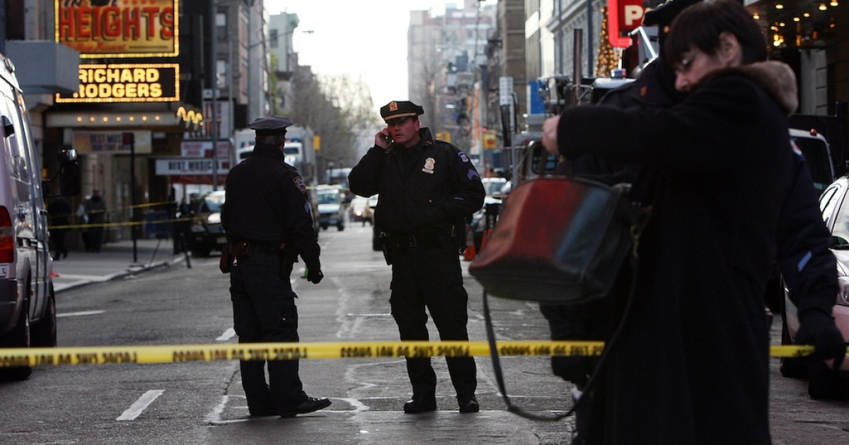 Police keep watch outside the Marriott Marquis in Times Square following a shooting incident December 10, 2009 in New York City. An undercover police officer exchanged fire with a Times Square street vendor, killing him near the Marriott Marquis hotel.</p>