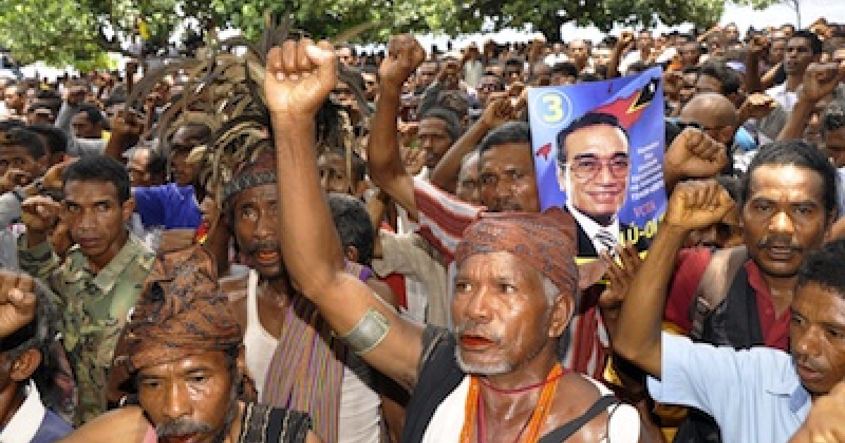 Supporters of Fransisco Guteres, also known as Lu Olo, shouts slogans during a campaign in Dili on March 10, 2012. The March 17 presidential election will be the second since the nation was officially recognised as independent in 2002.</p>