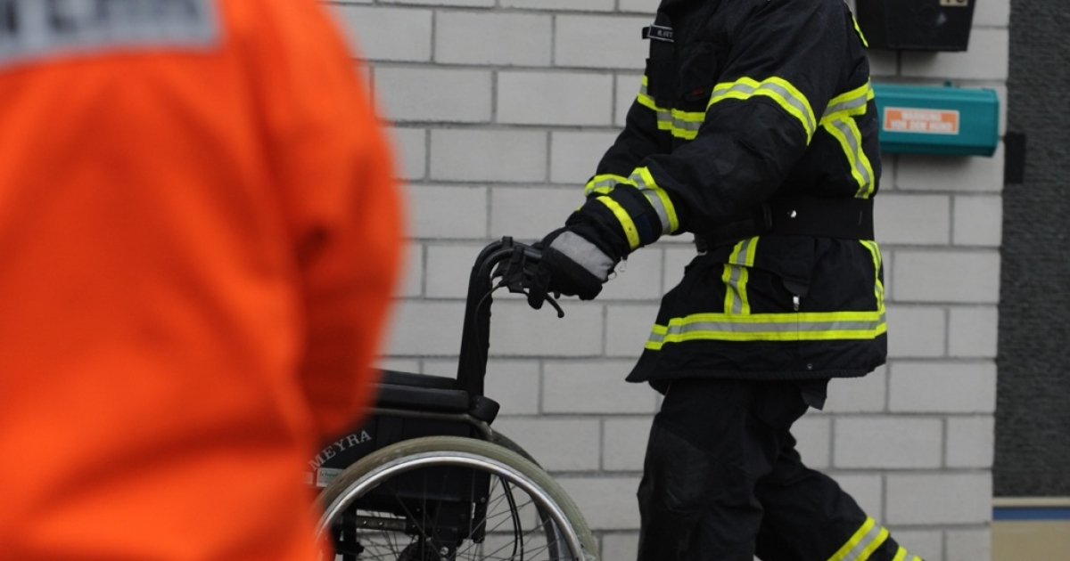 A firefighter at the scene of the fire at a training center for disabled people in Titisee-Neustadt, southern Germany, on Nov. 26, 2012.</p>