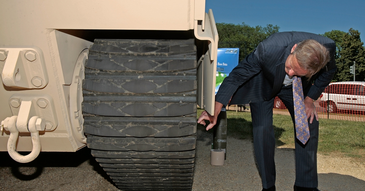 Tank assault: Rep. Todd Akin (R-MO) takes a closer look at a military vehicle on the National Mall in Washington, DC. Akin's comments about rape and abortion have gone viral and could infect other Republican campaigns than just his own.</p>