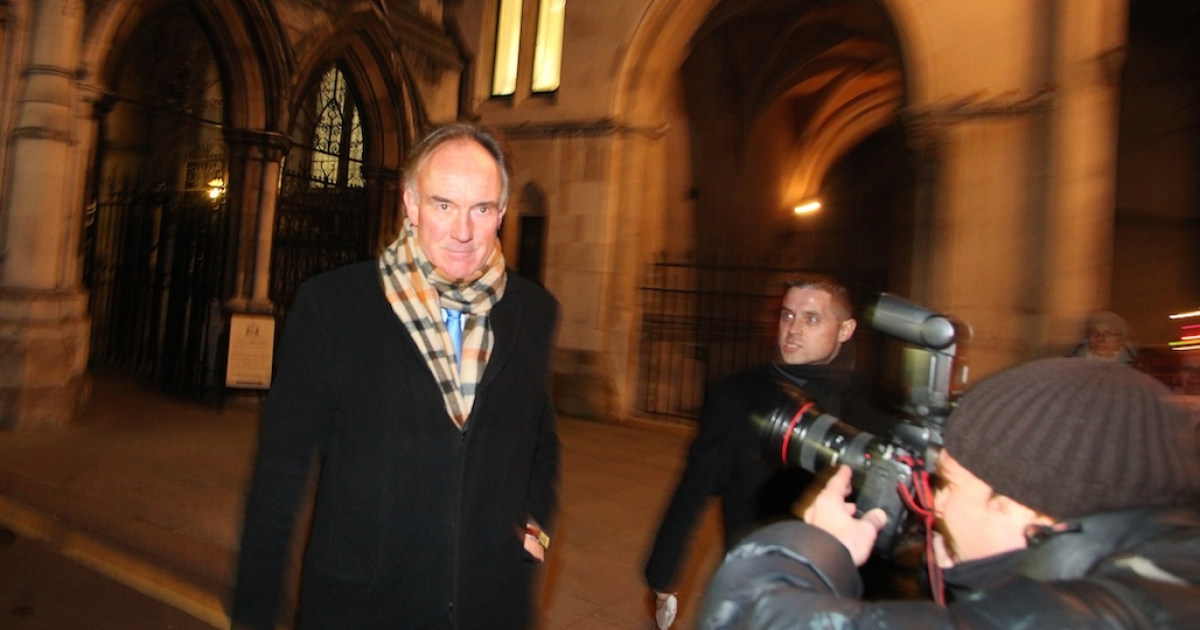 Former News International lawyer Tom Crone leaves the High Court in central London after giving evidence at the Levinson inquiry into press regulation and phone hacking in London on December 13, 2011.</p>