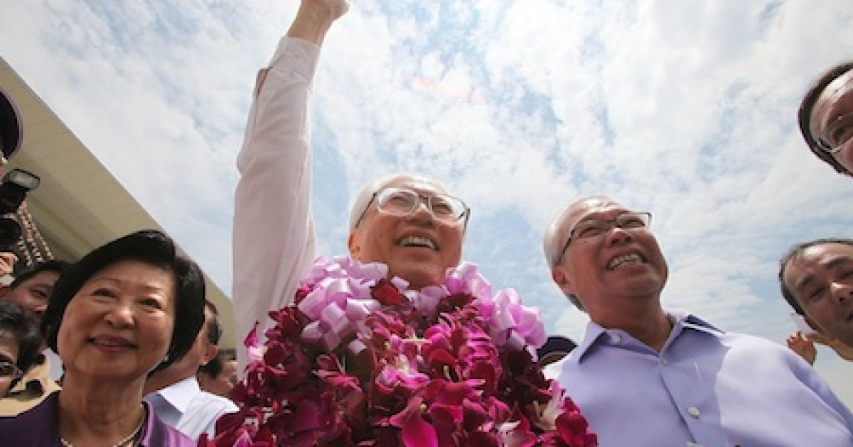 Singapore's newly elected president, Tony Tan, raises a fist on the campaign trail.</p>