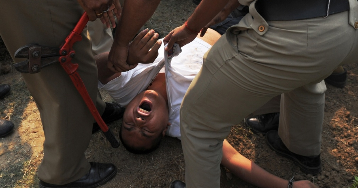 A pro-Tibet protester in New Delhi, after he tried to set himself on fire.</p>