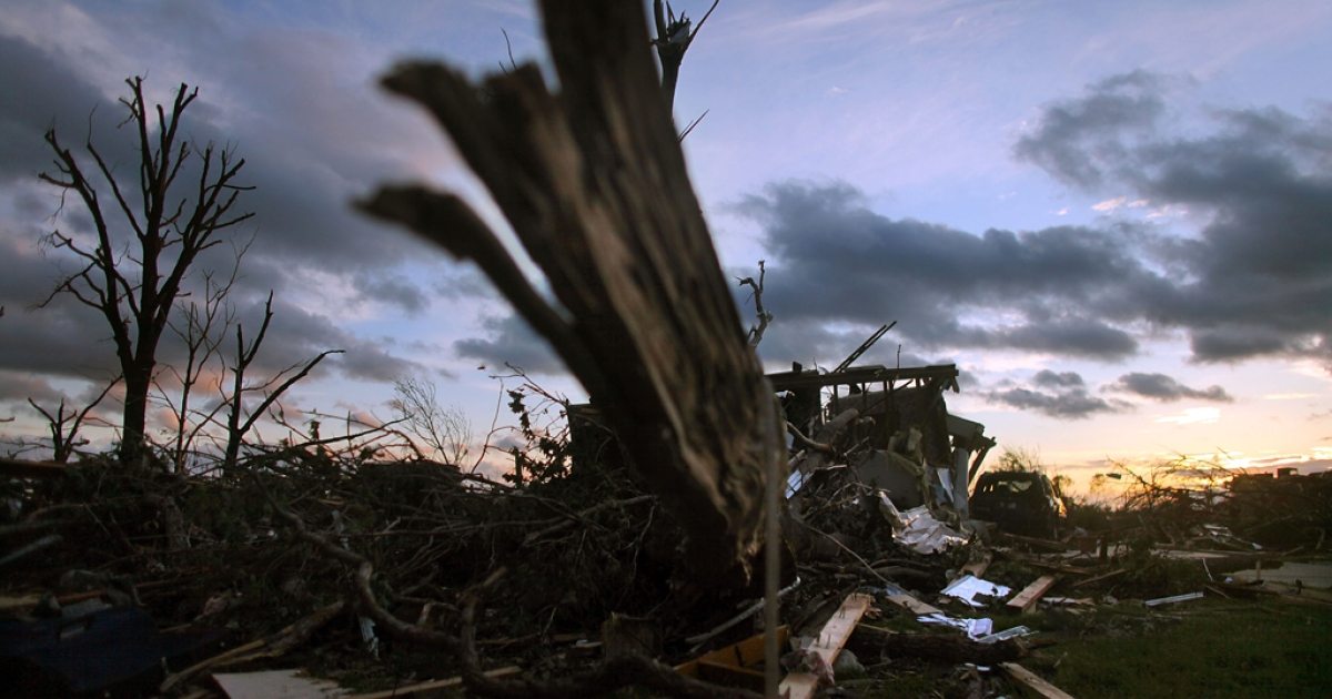 Destroyed trees and homes are seen at sunset after a massive tornado passed through the town killing at least 125 people and injuring around 900 in Joplin, Missouri.</p>