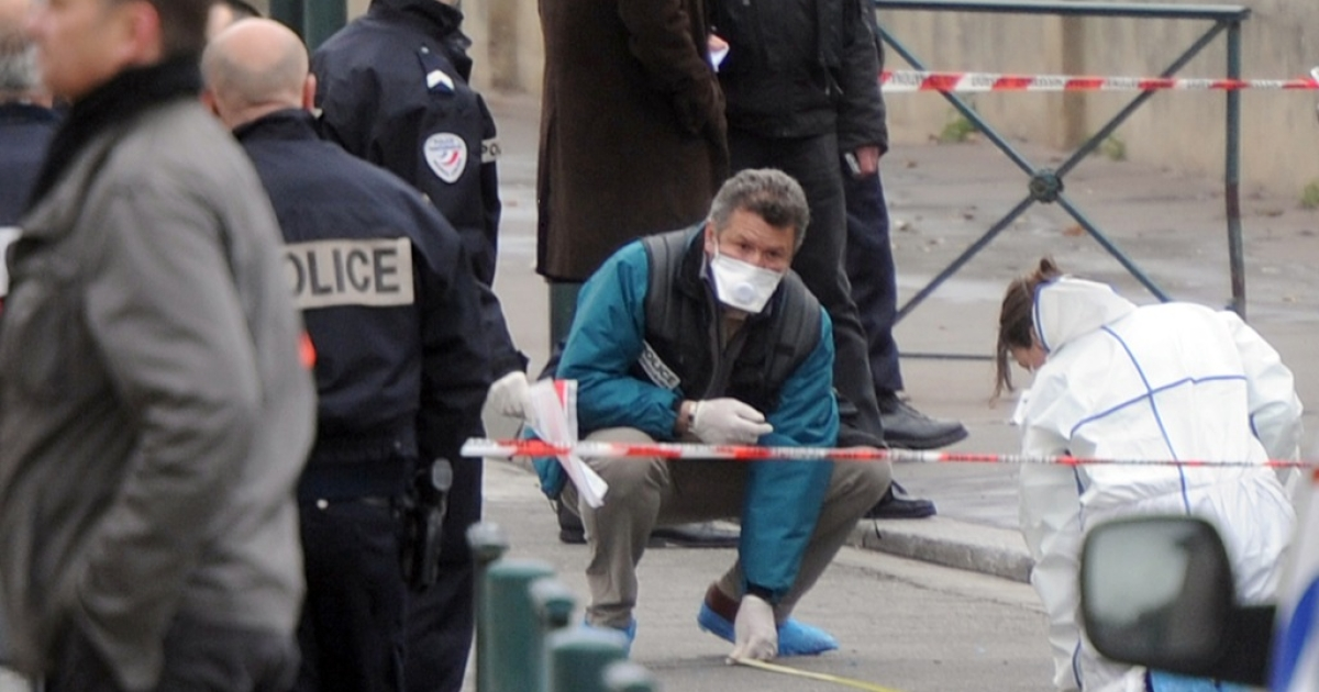 Police forensic teams working outside the Jewish school in Toulouse where three children and a rabbi were murdered today.</p>