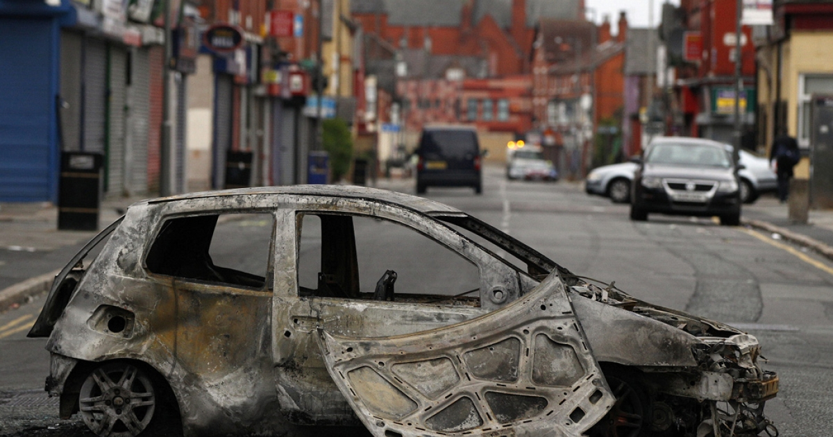 A burnt out car in Liverpool's Toxteth neighborhood from this past summer's rioting.  Exactly 30 years ago riots tore the same area leading some members of then Prime Minister Margaret Thatcher's cabinet to argue that the city should be abandoned, according to papers released today.</p>