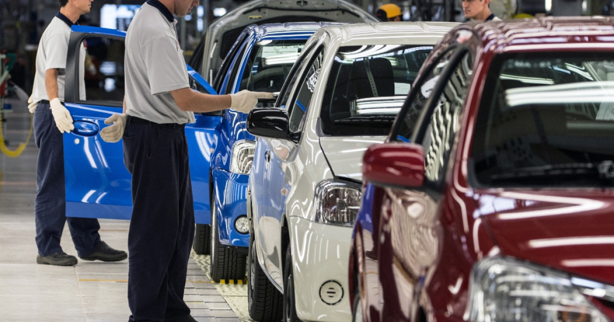 Toyota's workers are trained to examine the new compact car, ETIOS, at the new factory in Sorocaba, about 100km west of Sao Paulo, Brazil on August 9, 2012.</p>