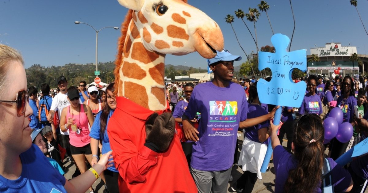 Geoffrey from Toys R Us greets participants of the 10th Annual Walk Now For Autism Speaks at the Rose Bowl on April 21, 2011 in Pasadena, California.</p>