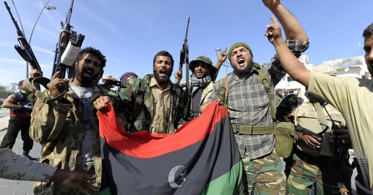 Fighters celebrate the fall of Sirte.</p>