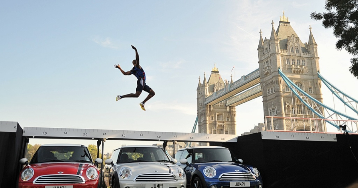 London 2012 Olympics long jump hopeful British athlete J.J. Jegede successfully jumps over the roof of three MINI cars in central London, on September 28, 2011.</p>