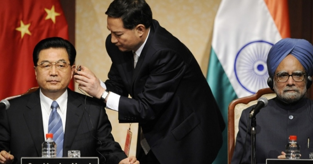 Chinese President Hu Jintao is helped by an aide to set up a headphone for translation as Indian Prime Minister Manmohan Singh looks on. If a consortium of Asian nations have their way, machine translation will someday take the place of human translators.</p>