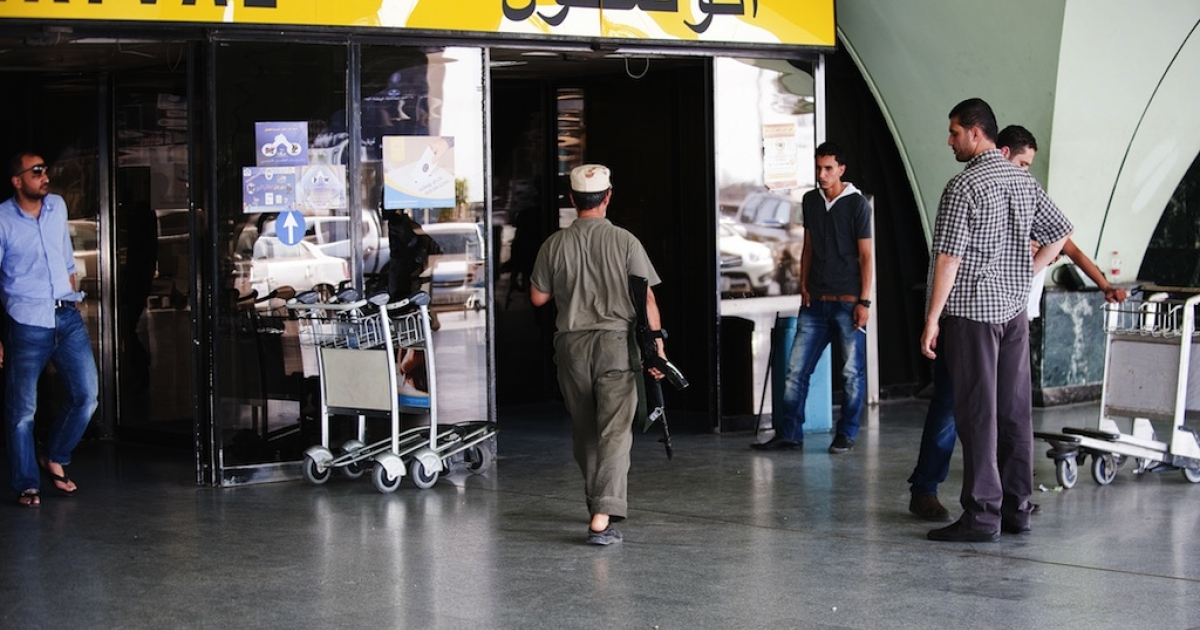 An unidentified armed man walks towards the arrivals hall inside Tripoli's international airport on June 4, 2012 after it was overrun by the al Awfea militia of Libyan ex-rebels who surrounded planes with tanks, grounding all flights following their leader's apparent arrest, according to officials. The official Lana news agency, citing witnesses, confirmed the 'assault' by gunmen who fired into the air and slightly wounded an airport employee, causing panic among travellers.</p>