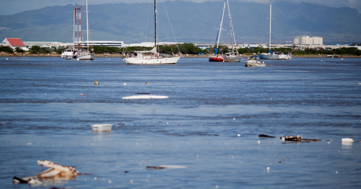 Debris floats in Keehi Boat Harbor on March 11, 2011 in Honolulu, Hawaii, after a tsunami swept through the area. Tsunami waves rolled thousands of miles across the Pacific Ocean after a massive earthquake off Japan.</p>