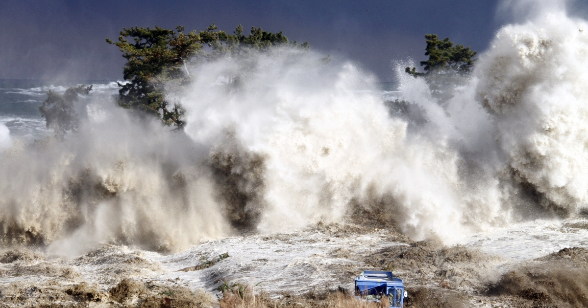 Tsunami waves hit the coast of Minamisoma in Japan's Fukushima prefecture, March 11, 2011.</p>