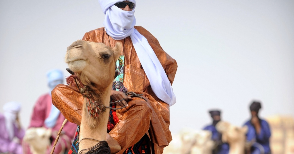 "Tuareg men ride camels during the annual Assihar festival in Tamanrasset, southern Algeria on April 4, 2011. The annual festival presents Tuareg culture and €""concerts, dances, traditional games, presentation of artisans' works.</p>"