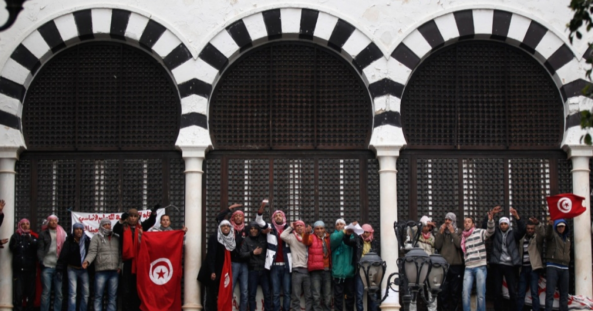 Tunisians demonstrate outside Prime Minister Mohammed Ghannouchi's offices in Government Square Tunis on January 25, 2011 in Tunis, Tunisia.</p>