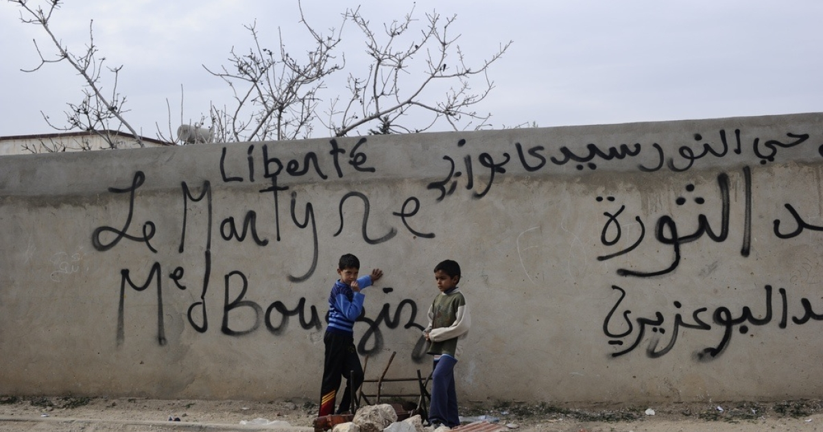 Children play in a street where Mohamed Bouazizi used to live in Sidi Bouzid on Jan. 20, 2011.</p>