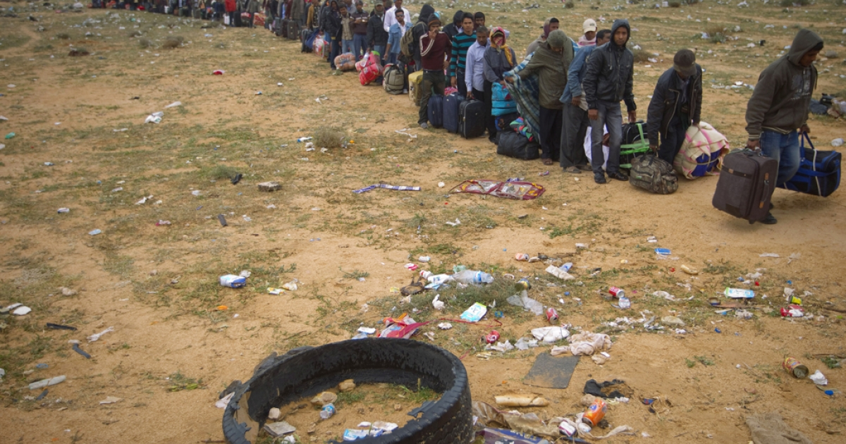 Bangladeshi refugees wait to get on a bus to the Jerba airport at the Tunisian transit camp of Choucha on March 15, 2011.</p>
