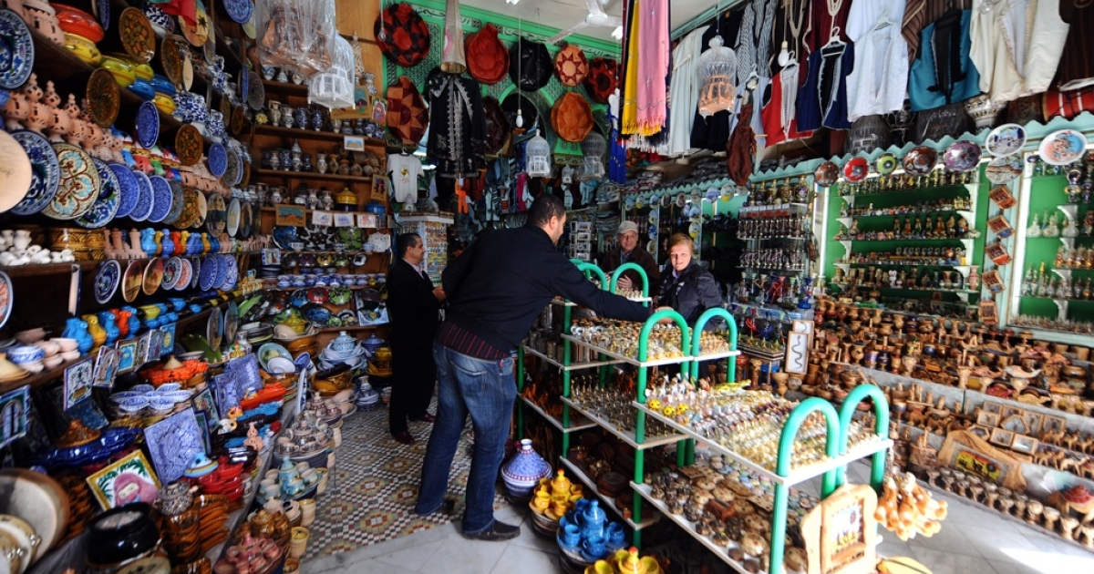 European tourists visit handicraft shops in a medina souk on February 15, 2011 in Tunis. Despite political instability and state warnings following the ouster of President Zine El Abidine Ben Ali, a few tourists still visit Tunisia.</p>
