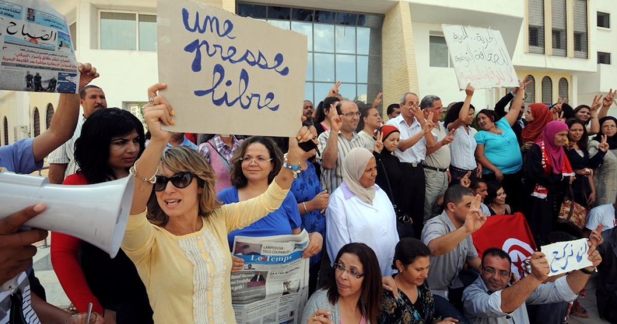 Tunisian journalists of Assabah Daily hold signs calling for freedom of the press during a protest in Tunis on September 11, 2012. Since the government appointed overseers for the country's media outlets, journalists have held a number of protests and recently had a general strike.</p>