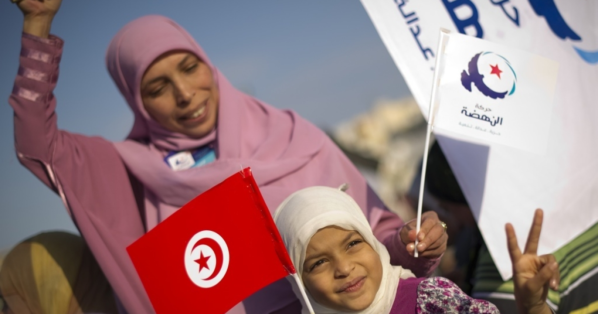 A Tunisian woman and her daughter attend a rally of the Islamist Ennahda party in southern Tunis on Oct. 21, 2011.</p>