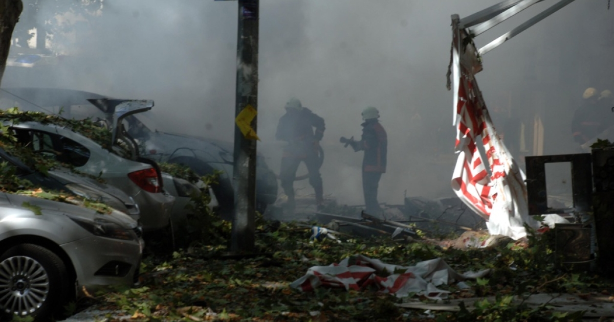 Turkish firefighters work at the site where a suspected car bomb exploded, wounding more than a dozen people in the center of the Turkish capital Ankara.</p>