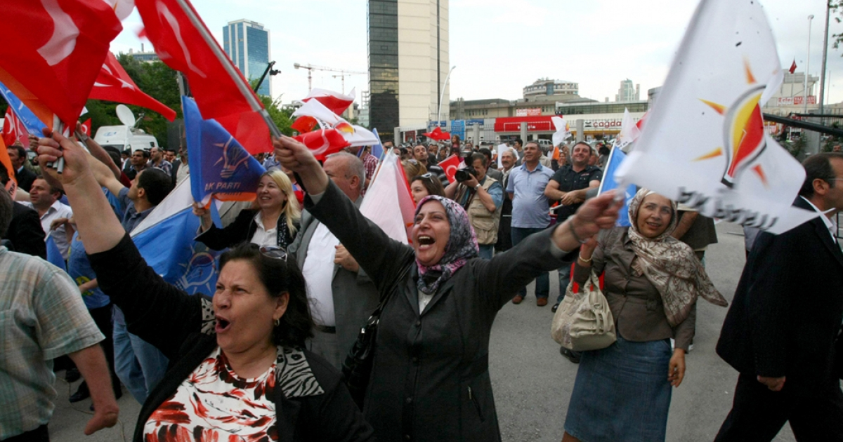 Supporters of Turkey's ruling AKP party celebrate after the first results of the parliamentary election, in Ankara, on June 12, 2011. The AKP took a 54.8-percent lead in today's general polls, with 30 percent of the vote counted.</p>